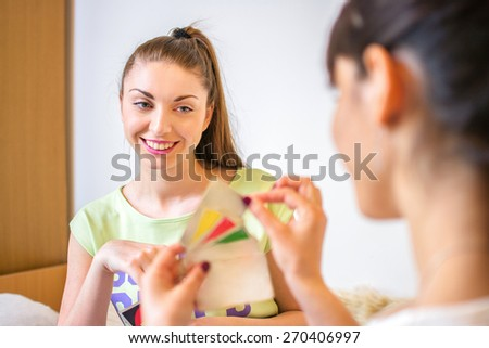 Two girls playing cards. - stock photo