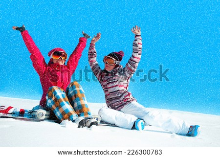 Two girls playing with snow    - stock photo