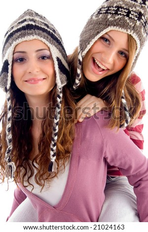 two girls showing happiness together on an isolated white background - stock photo