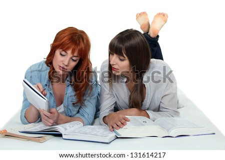Two girls studying together - stock photo