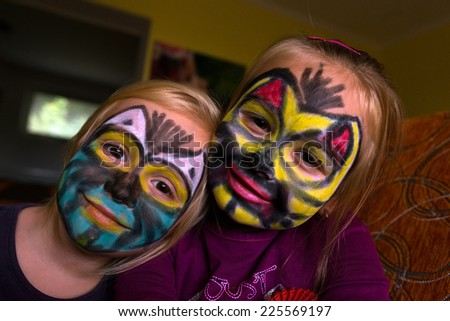 two girls with painting face - stock photo