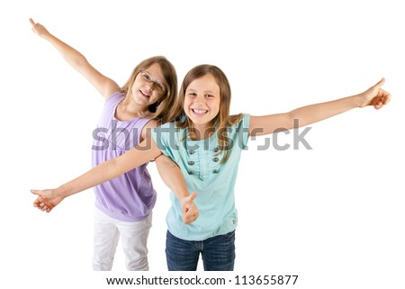 two girls with thumbs up - stock photo