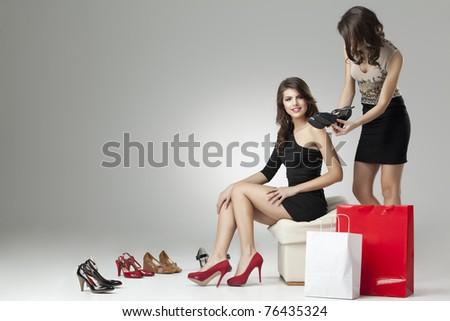 two glamorous women shopping high heels - stock photo