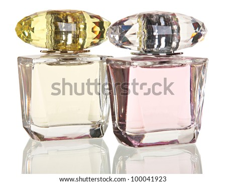 Two glass bottles of female perfume isolated on a white background - stock photo