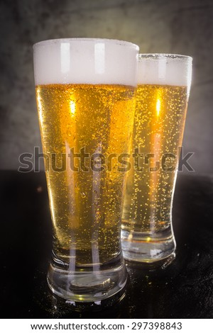 two glasses of beer over vintage background - stock photo