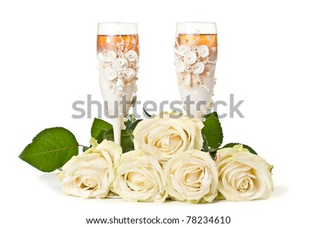 Two glasses of celebratory champagne with white roses - stock photo