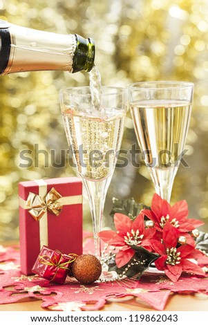 Two glasses of champagne and decorations. - stock photo