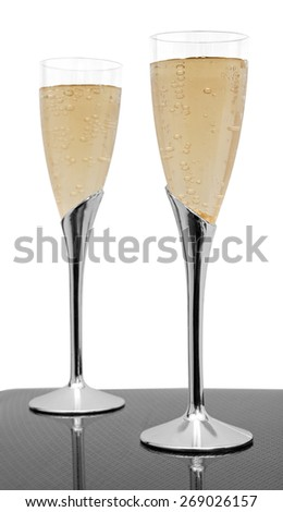 two glasses of champagne isolated on white - stock photo