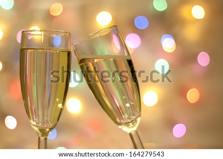 Two glasses of champagne on blurred new year party background - stock photo