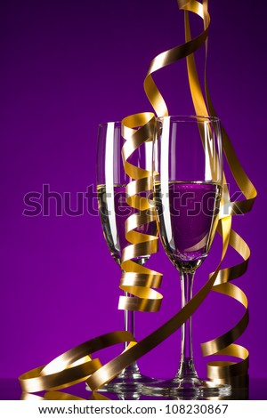 Two glasses of champagne on purple background - stock photo