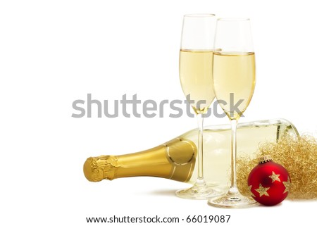 two glasses of champagne with angels hair, red christmas ball in front of a champagne bottle on white background - stock photo