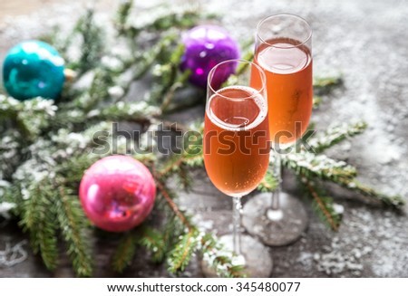 Two glasses of champagne with Christmas tree branch - stock photo
