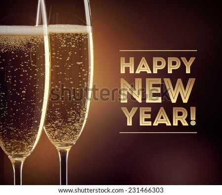 Two glasses of champagne with happy New year text on black background - stock photo