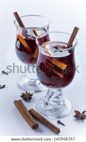 Two glasses of mulled wine isolated on white background - stock photo