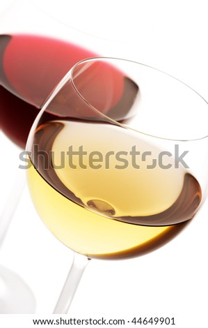 Two glasses of red and white wine close-up on white background. - stock photo