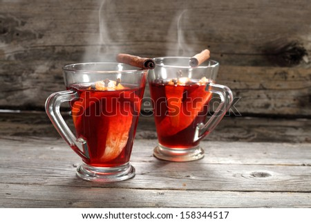 two glasses of red hot drink  - stock photo