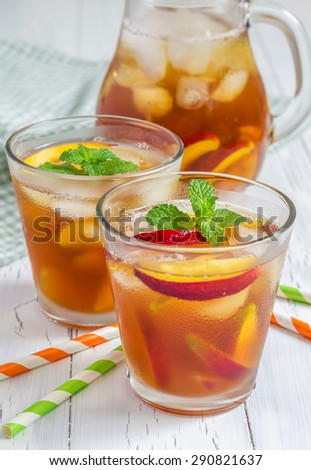 Two glasses of refreshing homemade peach iced tea - stock photo