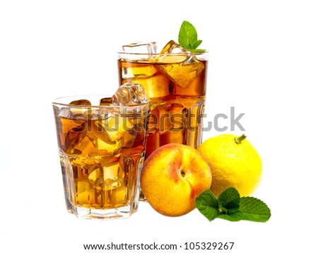 Two glasses of refreshing peach, lemon and mint ice tea - stock photo
