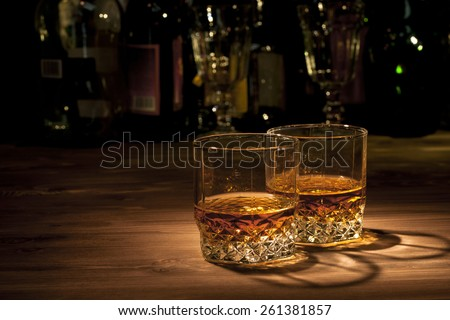 Two glasses of whiskey on a wooden table in the bar - stock photo