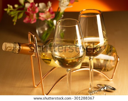 Two glasses of white wine - stock photo