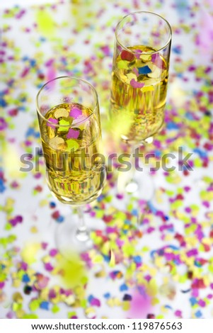 Two glasses of  wine and falling confetti - stock photo