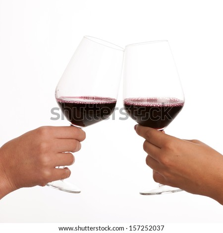 two glasses of wine in hands isolated over white - stock photo