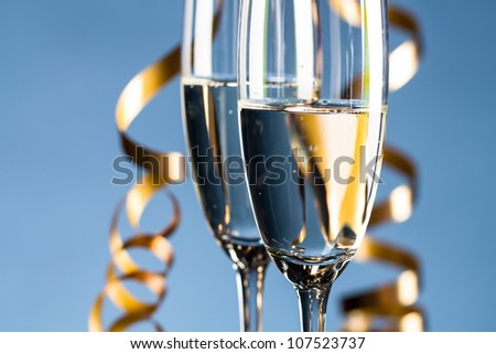 Two glasses on light blue background - stock photo