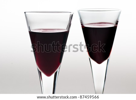 Two glasses wine on a white background . - stock photo