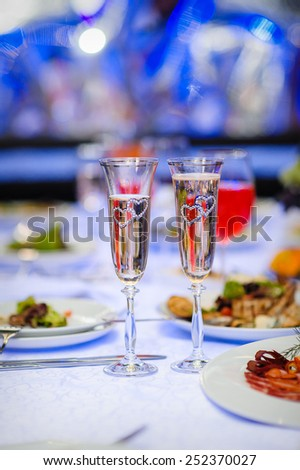 two glasses with champagne. - stock photo