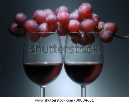 Two glasses with red wine and grape. - stock photo