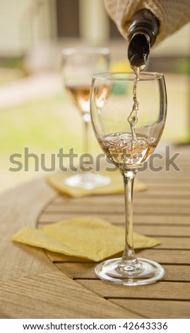 Two glasses with white wine - stock photo