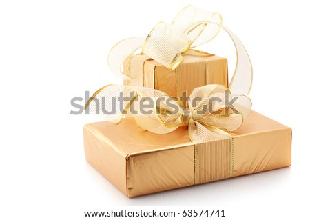 Two gold foil gifts with golden bows isolated on white background. - stock photo