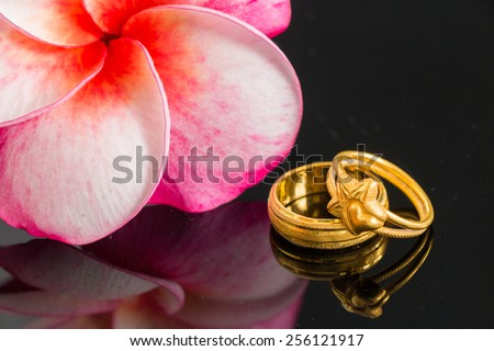 Two golden ring with pink orchid (Love concept) - stock photo