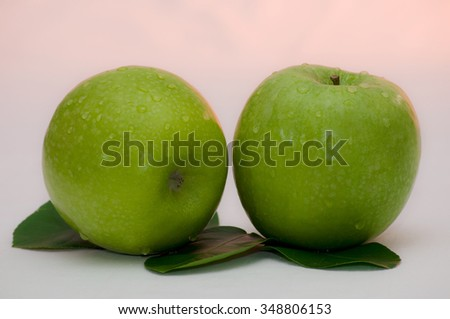Two green apples isolated on white background - stock photo
