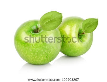 Two green apples with leaves - stock photo