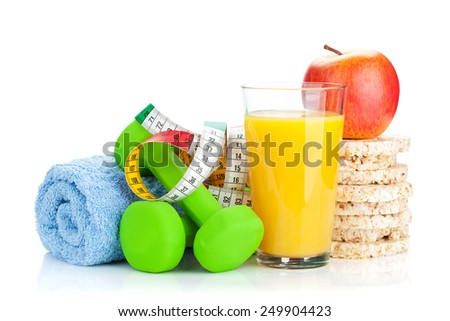Two green dumbells, tape measure and healthy food. Fitness and health. Isolated on white background - stock photo