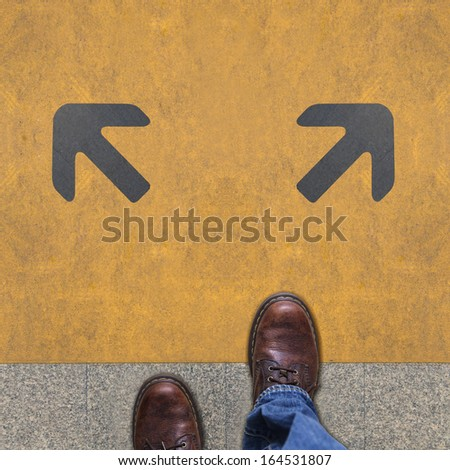 Two grey arrows on the yellow background - stock photo