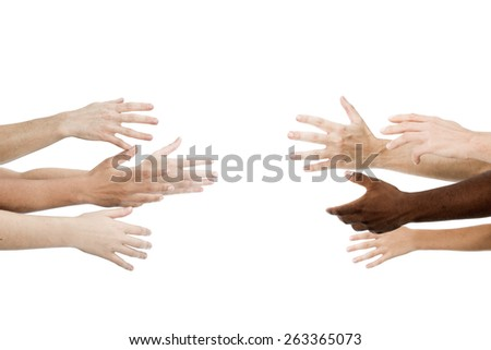 Two group of people reaching for each other - stock photo