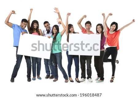 Two Group's of Asian people holding a big banner for your message. Indian and Chinese teams holding placards and celebrating good news. Isolated over white background. - stock photo