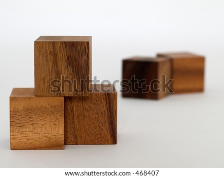 Two groups of building blocks separated by shallow depth of field - stock photo