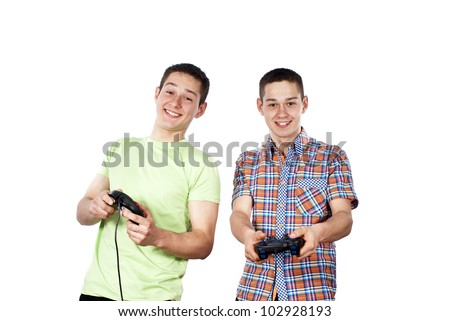 Two guys play computer games on the joysticks isolated - stock photo