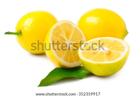 two half lemons and whole lemons on a white background. - stock photo