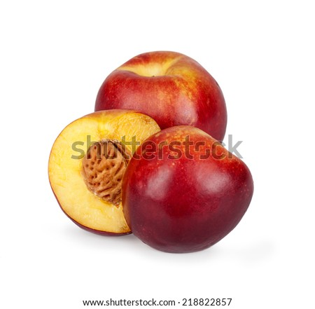 two half nectarine on the background of a fruit in isolation - stock photo