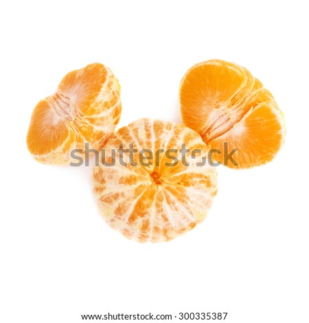 Two halves and whole fresh juicy peeled cleaned tangerine ripe fruit isolated over the white background - stock photo