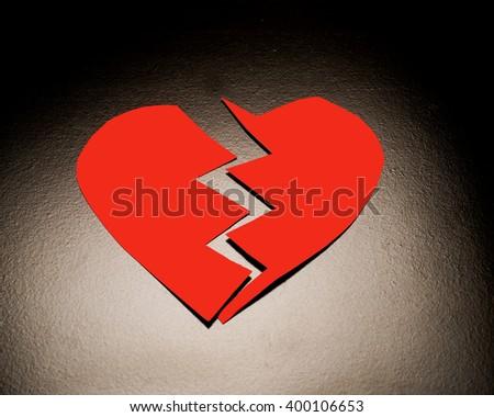 Two halves of a hearth/Broken Heart/Broken Valentine symbolizing breakup in a relationship - stock photo