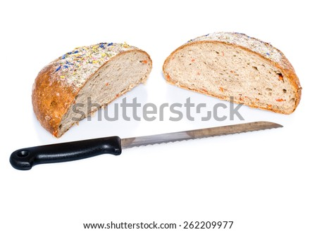 Two halves of loaf of bread with knife deliciously decorated with dried flowers isolated on white - stock photo
