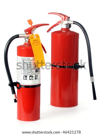 Two  hand-held home or office fire extinguishers.  The small one demonstrates how it should be used and contains a blank monthly inspection tag.  Isolated on white. - stock photo
