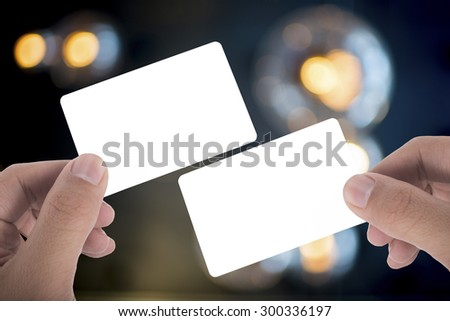 two hand hold blank card over beautuful background - stock photo