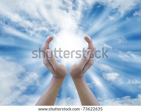Two hand holding the sun - stock photo