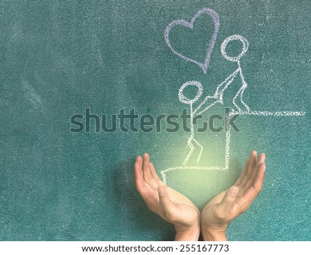 two hand put the Lover are confederating for success on blackboard background - stock photo